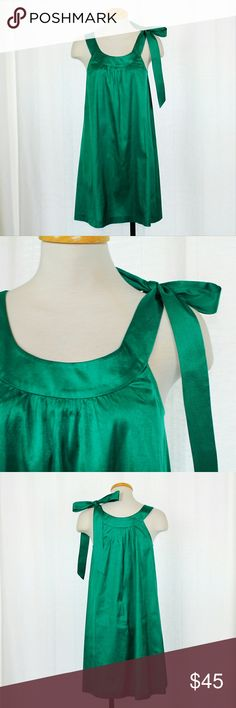 NWOT Theory Emerald Green Shoulder Tie Dress Gorgeous emerald green distressed silk dress from Theory in NWOT condition. Features a beautiful bow tie at the shoulder for a touch of elegance. Perfect for any formal occasion, or for a St. Patrick's Day party!  100% Silk  Please let me know if you have any questions or need more pictures. I will consider all reasonable offers, but no trades, please. Theory Dresses