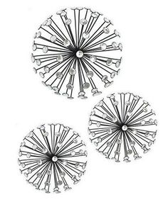 The sun shape adds whimsy and versatility, great for indoor or outdoor use. Ready to hang. Black metal starburst wall art with faceted and mirrored crystal at the end of each ray. | eBay!