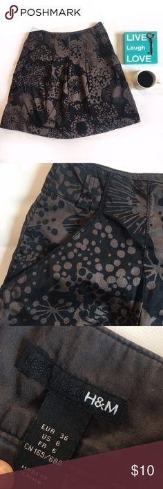 H&M Floral Brown Skirt Never worn. Cute floral design. Various Shades Of Brown and Black. Has A Zipper On The Side, Can Easily Tuck In A Blouse Into It. Has Thin Lining Underneath. I'm 5'2 and It Comes Below The Knee. Excellent With High Boots! H&M Skirts Midi