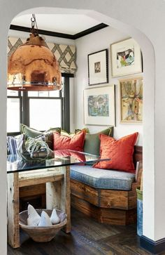 In this cozy dining nook, a banquette layered with pillows provides ample space for guests. - Photo: Dustin Peck / Design: Catherine Macfee and Justine Macfee nook ideas Dining Set With Bench, Dining Nook, Banquette Dining, Nook Table, Kitchen Nook, Kitchen Decor, Kitchen Furniture, Kitchen Design, Estilo Country