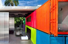 Decameron (Sao Paulo, Brazil) Architects Marcio Kogan and Mariana Simas of Studio MK27 turned an empty urban alley into a neon-drenched retreat, complete with a small garden, by repurposing shipping containers. Photo by Pedro Vannucchi