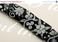 ON SALE 30% OFF Glass Lampwork Bead Sets - Seven Midnight Garden Pillow Beads  - 10204204. $38.50, via Etsy.