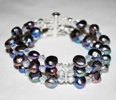 Triple Bangle Bracelet, made of natural pearls of culture of silver color with reflections of different shades, and tiny crystals.