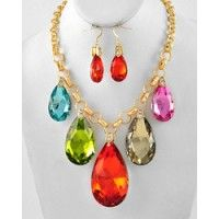 "Chunky gold tone multi color rhinestone graduating teardrop charm necklace and earring set.  Material:  Rhinestone and glass  Size:  Necklace:  17 1/2 + 3 inch extension, 3 1/4 inch drop  Earrings:  2"" long $32.99"