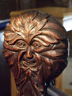The pews are black with age, and at their ends are Green Men—an ancient symbol blending nature and mankind, depicted as a man whose hair and beard are made of leaves and vines—and Trees of Life.