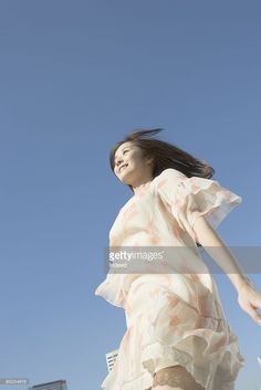 Stock-Foto : Young woman walking, low angle view