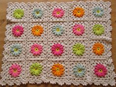 With a great crochet flower pattern, the Daisy Granny Square Blanket definitely gives off a lovely sixties vibe.  | AllFreeCrochetAfghanPatterns.com