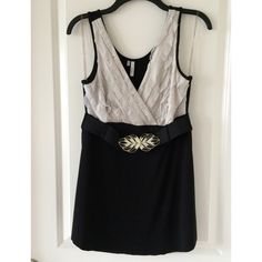 Black and white belted top studio y long tank with belt medium dressy looks great by itself or with a light jacket item is free from rips, tears and staining no swaps or trades reasonable offers accepted Studio Y Tops