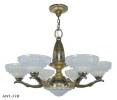 Outstanding Ezan style French Art Deco Chandelier. The fixture is from about 1920-30 and are show some of the finest of french glass making. The glass shades are fully and deeply embossed with the protruding art iceberg drippling so typical of Ezan lighting.