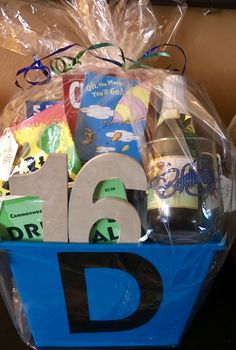 """A Personalized 16th Birthday Basket! I made this personable gift basket for my son's 16 years of awesomeness & blessings.It consisted of his favorite things & more.A special little blank notebook with Dr. Seuss """"Oh the places you'll go...""""(I wrote in 16 life lessons),a drivers' manual, snacks,drinks...( typical teen) & Also, including a mini cider (toast to his milestone birthday! )Each gift had a message.""""Life is good when you can just snack! Most favorite gift was@bottom(gold…"""