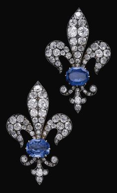 A pair of antique sapphire and diamond brooches, late 19th century. Each…