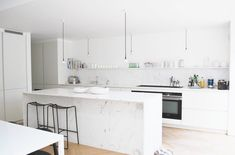The pale marble encases three sides of the kitchen island. Open Shelving, Shelves, White Interiors, Modern Kitchens, Simple Colors, Open Plan Kitchen, All White, House Tours, Kitchen Island