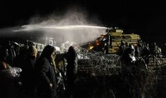 Image: Police use a water cannon on protesters during a protest against plans to pass the Dakota Access pipeline near the Standing Rock Indian Reservation, near Cannon Ball, North Dakota, U.S.