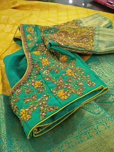 Stunning sunshine yellow and sea green color combination pattu saree and sea green color designer blouse with floret lata design hand embroidery gold trhead and kundan work allover. Pattu Saree Blouse Designs, Fancy Blouse Designs, Bridal Blouse Designs, Blouse Neck Designs, Diana, Wedding Saree Blouse, Maggam Work Designs, Embroidery Fashion, Hand Embroidery