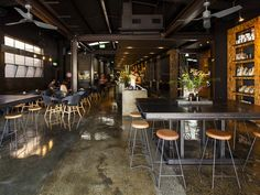 Code Black Coffee: Two Melbourne Warehouses Merge to Create Industrial Chic Cafe and Roastery
