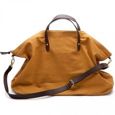 this is adorable. love the brown mustard color too. Canvas and Leather Weekender Bag