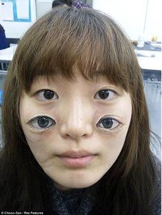 Freaky body art - Chooo-San, a first year student at Musashino Art Universityin Tokyo, Japan, paints misplaced mouths, extra eyes and eerie robotic extras to the human body.