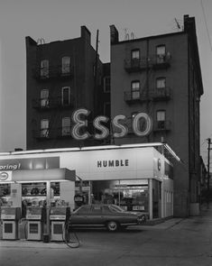 Esso Station and Tenement House, Hoboken, NJ, 1972  George Tice