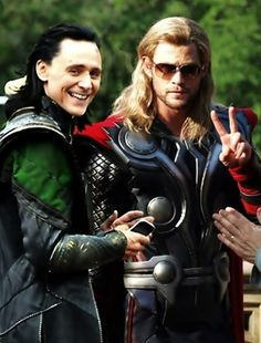 Chris Hemsworth and Tom Hiddleston on the set of Thor 2. That peace sign is great.