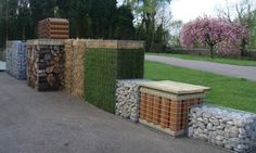 gabion raised garden beds. unique fillings add astro to sit on or cover sides maybe?