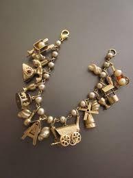 Bildergebnis für ringe mit anhängern charms vintage