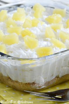 no bake pineapple dream dessert topped with pineapple and coconut in dish