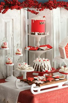 Christmas Dessert Table - love the idea of using a small sleigh as a serving piece