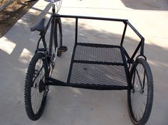 2 bikes from thrift. from one - remove seat & front tire/forks, configure connecting bars/floor, bolt to both frames, paint. add standing passenger trailer behind working bike for roadside scrap gathering.