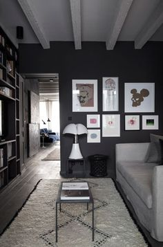 living room with grey walls in Lyon apartment by Maison Hand My Living Room, Living Room Interior, Living Spaces, Dark Walls, Grey Walls, Charcoal Walls, St Georg, Swedish Interior Design, Decorating Your Home