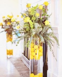 lemon-filled arrangements flank a fireplace at this reception.
