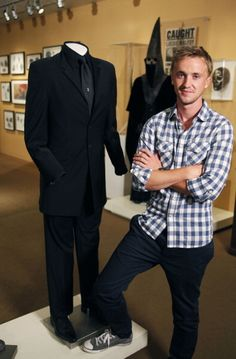 Tom Felton standing next to the suit he wore in Harry Potter and the Half-Blood Prince!