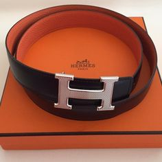 Authentic Hermes belt 100% authentic Hermes belt. Approx. 44 inches or 113 cm. Unisex. Fits a mens 34-36 or can have extra holes put in to fit a womans 29-31. Reversible with soft black leather and orange pebbled leather. Silver buckle with embossing. Includes box and bag for buckle. Belt is in pristine condition and has only been worn 2x and stored in the box when not in use. Hermes Accessories Belts