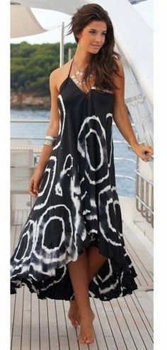 Don't hold back your love for this gorgeous Gentle Winds maxi! It features a beautiful black and white pattern with an open halter tie back neck and irregular hem. TheChicFind.com