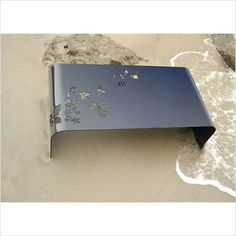 flowering branch cut-out metal bench