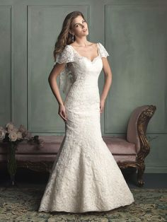 Allure Bridals 9123 Allure Bridal  Love the lace butterfly sleeves down the back and the Mediterranean feel.