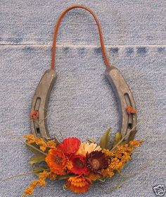 Hanging Flower Horseshoe, this would be cute different colors like twine to hang and white flowers this would be easy and cute DIY