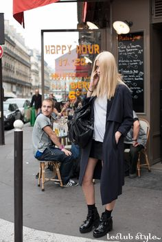 Womenswear Street Style by Ángel Robles. Fashion Photography from Paris Fashion Week. Casual outfit, biker ankle boots, black trench and black backpack. On the street, Rue du 4 Septembre, Paris.
