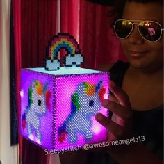 Commission glow in the dark unicorn rainbow perler bead light box. #sleepystitchshop #unicorn #rainbow #glowinthedark #colorful #perler #perlerbeads #hama #hamabeads #fusebeads #meltybeads #artkal #artkalbeads #8bit #pixel #sprite #handmade #homemade #magical #light #lightbox #box #lighting #nightlight #fandom #geek #nerd