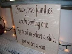 """Seating sign. """"Today, two families are becoming one. No need to select a side, just select a seat."""""""