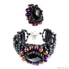 Dazzle the night away with this handmade jewelry set. Lai used sparkling crystals to form this exquisite design. This set includes a ring and bracelet. ~Exquisite Beauty Mix Color Crystals Bracelet and Ring Set~ SKU: SS-0088-MIX
