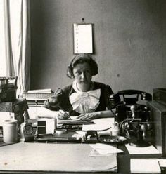 Miep Gies behind her desk at the Opekta office, Amsterdam, 1938