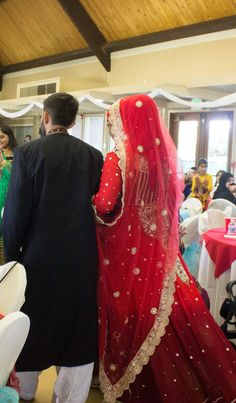 Shaadi wedding dress Indian Pakistani style lengha gown red silver and gold with grooms black red silver and gold sherwani hijabi bride