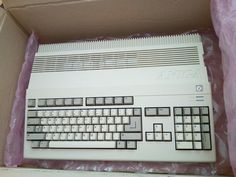 A nice package with an Amiga 500 Gaming Computer, Computer Keyboard, Retro, Video Games, Childhood, Laptop, Apple, Memories, Wall