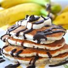 """Chunky Monkey Pancakes        """"I love banana pancakes and my daughter loves chocolate chip pancakes, so we came up with this yummy recipe to make us both happy! Serve with a dollop of soft butter, a sprinkle of powdered sugar, sliced bananas, and whipped cream with a side of butter pecan or maple syrup."""""""