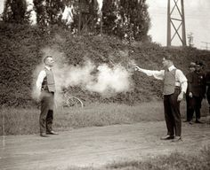 Testing a bulletproof vest, 1923 One man was shot thru a seem in the vest and nearly died as an artery was severed.