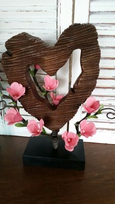 Handcarved wooden heart with pink blossoms. Shop more at https://squareup.com/store/azilorchids