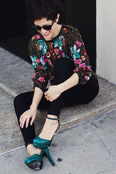 There is something just so irresistible about granny chic and, in this instance, I love how a top that would seem most appropriate in your elderly neighbor's closet looks totally modern when paired with skin-tight pants, sweet shades, and printed teal heels.