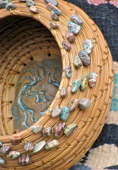 "Beautiful natural brown pine needle basket with sky blue jasper chip beads and a whimsical Kokopelli pottery base entitled ""Desert Dancers"""