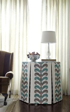 Tailored inverted pleat table skirt. Vervain's Ikat Leaves in color Seaglass.