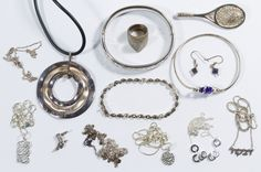 Lot 551: Sterling Silver Jewelry Assortment; Including seven chain necklaces, some with pendants, a circular pendant on a rubber necklace, a bangle bracelet, a link bracelet set with crystals and marcasite, a ring, a brooch, a pair of pierced earrings set with gemstones and a charm; all marked; together with a costume jewelry bangle bracelet